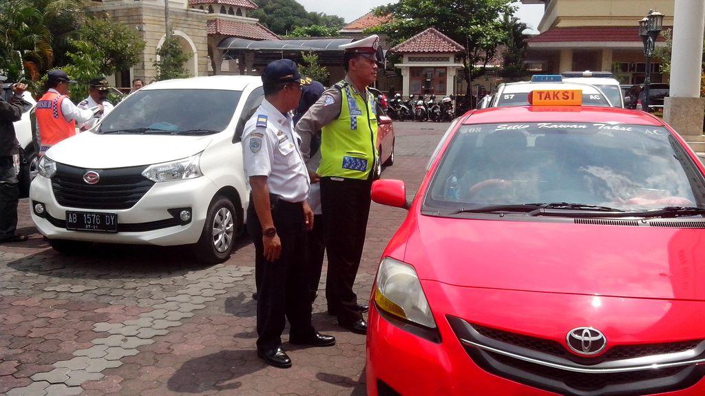 Apa Sanksinya Jika Taksi Online Melanggar Tarif Batas Bawah?