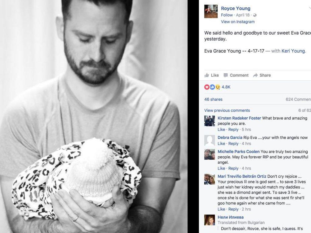 Kisah Sedih di Balik Foto Ayah yang Membopong Bayinya