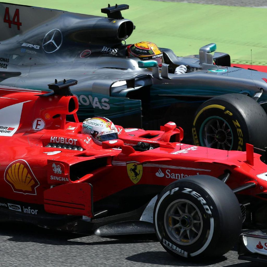 Hamilton Finis di Depan Vettel Usai Duel Sengit