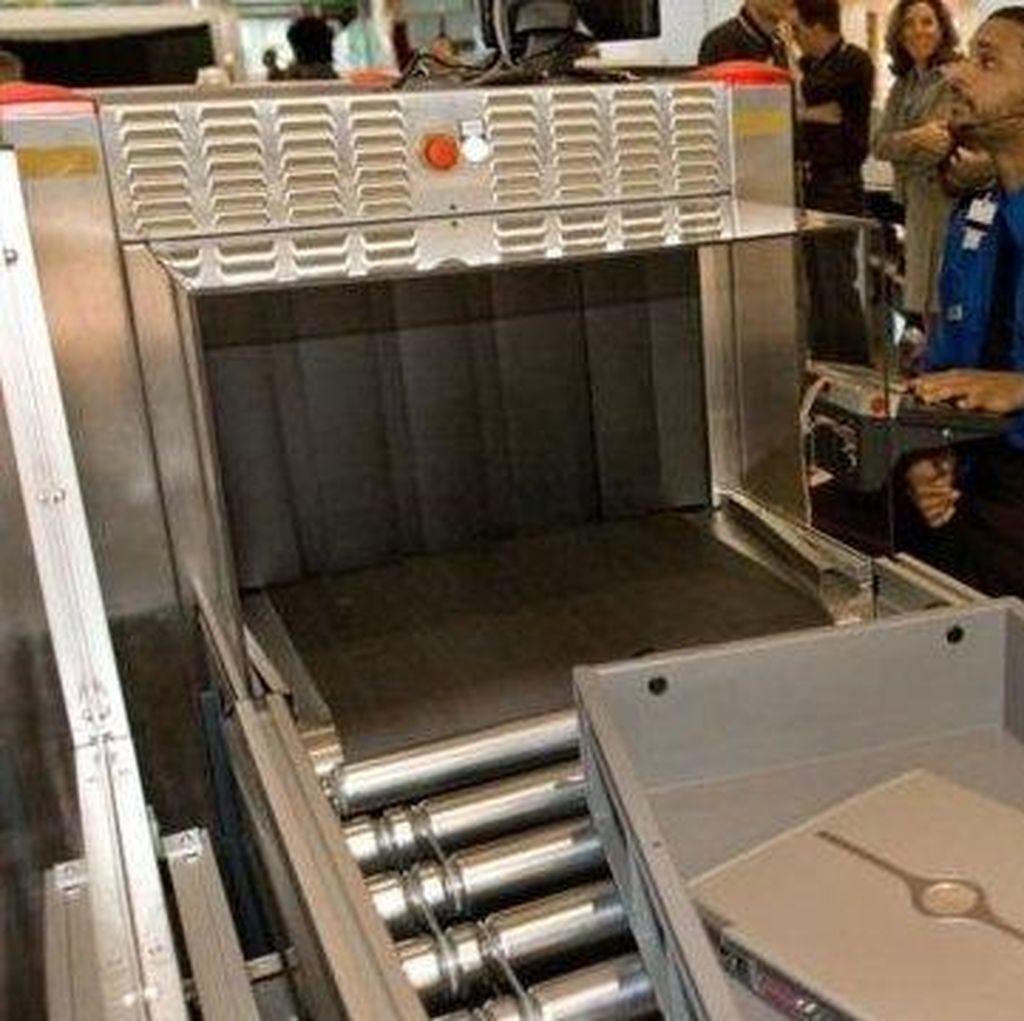 AS Berencana Larang Laptop di Semua Penerbangan Internasional
