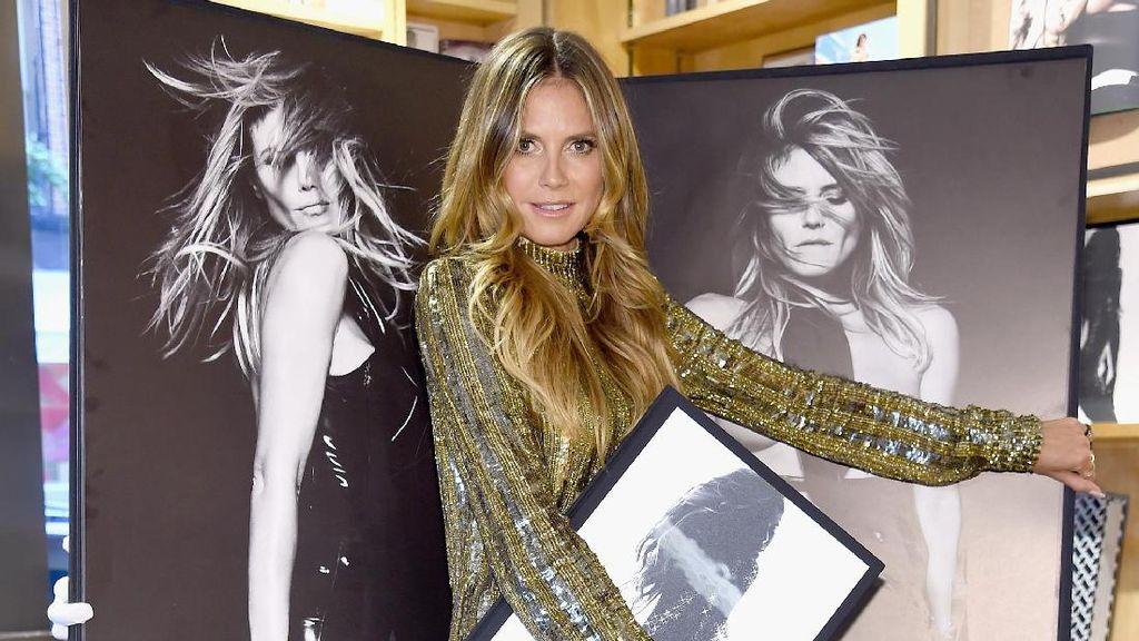 Heidi Klum Rilis Buku Kumpulan Foto Posenya Tanpa Busana