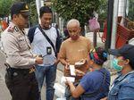 Polisi Cek Keaslian Uang di Tempat Penukaran Sekitar Kota Tua
