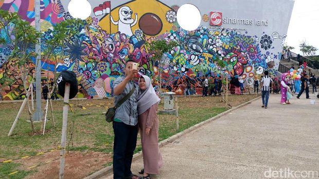 Rptra kalijodo jadi alternatif libur lebaran warga for Mural kalijodo