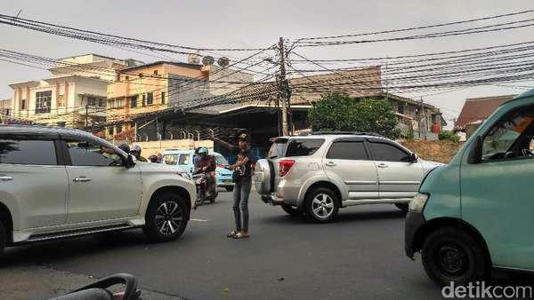 Polisi Akan Rekrut Pak Ogah, Pengamat: Asal Warga Tidak Bayar