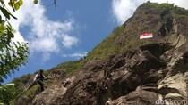 20 Tahun  Kibarkan Bendera Raksasa di Tebing Tertinggi se-Jatim