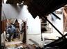 Atap rumah warga ambruk akibat gempa tersebut. AFP/Made Aly.