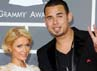 Paris pun menggandeng Afrojack saat melintas di red carpet Grammy Awards 2012. (Getty Images)