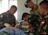 Tim kesehatan yang dipimpin Lettu Kes dr. Langgeng Gunariadi selaku Dokter Indobatt mengoperasi luka kepala yang dialami Mr. Abdullah warga Ettaibeh, Lebanon Selatan, Selasa  (3/7/2012). (Lettu Inf Suwandi)