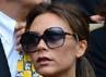 Victoria dan David Beckham menyaksikan pertandingan final Wimbledon di London, Inggris pada Minggu (8/7/2012). AFP PHOTO/Leon Neal.