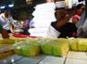 Nano (46), melayani konsumen yang membeli tahu di kiosnya di Pasar Kiara Condong, Bandung. Nano harus rela kehilangan sebagian pendapatannya akibat aksi mogok produksi yang dilakukan oleh para perajin tahu dan tempe. (Djuli Pamungkas/detikBandung).