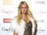 Paris Hilton mengenakan gaun bermotif leopard saat menghadiri acara Carpe Diem Lounge Club pada 3 November 2011 di Barcelona, Spanyol. Miquel Benitez/Getty Images.