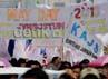 Mereka juga membawa berbagai spanduk salah satunya bertuliskan Jamsostum, jaminan sosial tolak upah murah