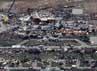 Tornado tersebut menghancurkan segala macam benda, mulai dari atap bangunan hingga dinding bangunan. Reuters/Rick Wilking.
