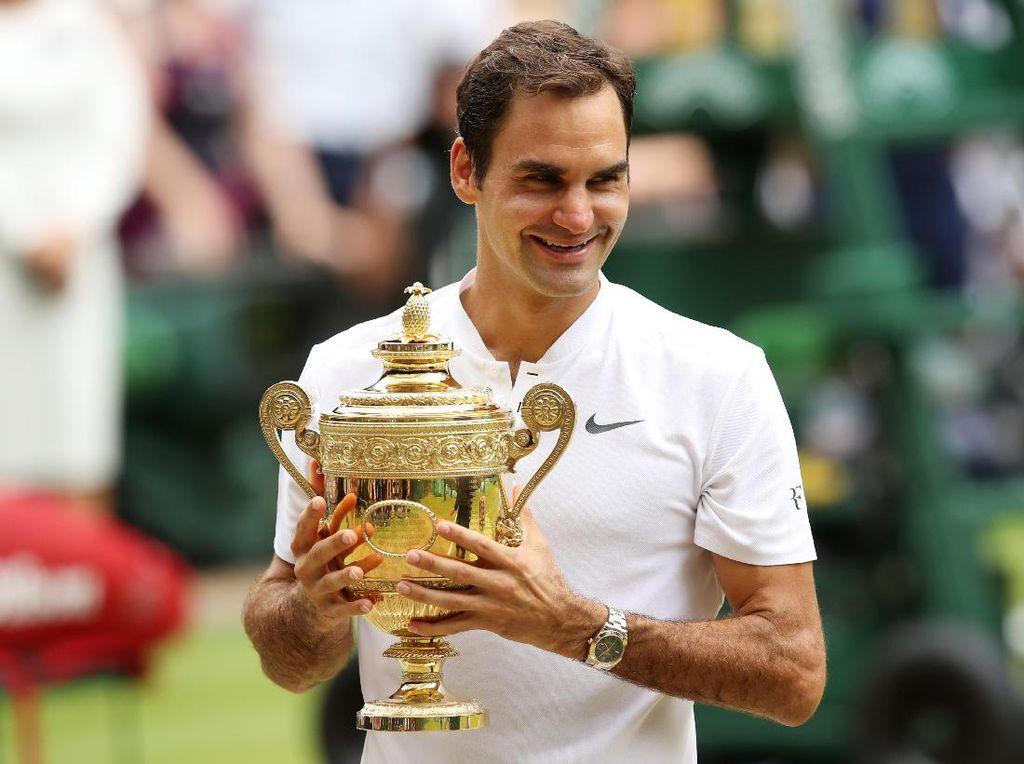 Federer kini secara keseluruhan sudah mengumpulkan 19 gelar grand slam. Foto: Julian Finney/Getty Images