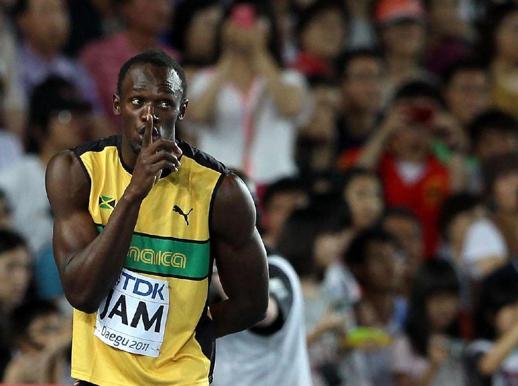 Bolt adalah pemegang rekor dunia 100m (9,58 detik), 200m (19,19 detik), dan 4x100m (36,84 detik pada Olimpiade Inggris 2012 bersama Yohan Blake, Michael Frater, Nesta Carter). (Ian Walton/Getty Images)