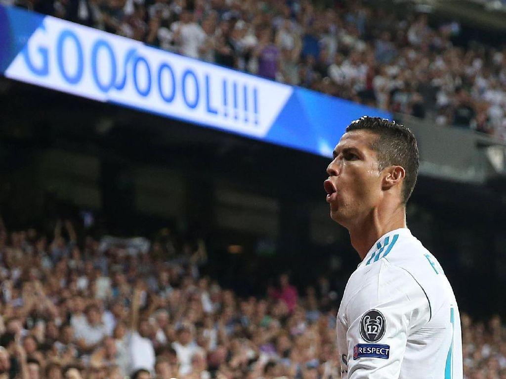 Seperti biasa, Ronaldo merayakan golnya itu dengan gaya khasnya. Foto: Sergio Perez/Reuters